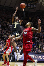 Purdue guard Eric Hunter Jr. (2) shoots over Rutgers guard Jacob Young (42) during the second half of an NCAA college basketball game in West Lafayette, Ind., Saturday, March 7, 2020. Rutgers defeated Purdue 71-68 in overtime. (AP Photo/Michael Conroy)