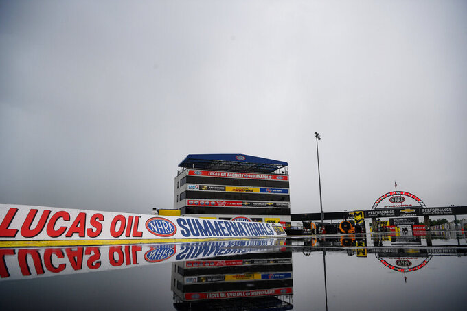 In this photo provided by the NHRA, water pools at Lucas Oil Raceway as the Lucas Oil NHRA Summernationals were postponed due to inclement weather in Indianapolis, Sunday, July 19, 2020. (Jerry Foss/NHRA via AP)