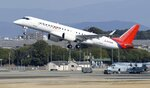 A SpaceJet, formerly known as MRJ, takes off during a test flight at an airport in Nagoya, central Japan, on March 18, 2020.  Japanese manufacturer Mitsubishi Heavy Industries is slashing spending for its repeatedly delayed regional jet, amid economic damage from the coronavirus pandemic.(Yuya Shino/Kyodo News via AP)