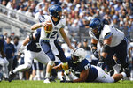 Villanova quarterback Daniel Smith (12) is sacked by Penn State defensive tackle PJ Mustipher (97) in the second quarter during an NCAA college football game in State College, Pa., on Saturday, Sept. 25, 2021. (AP Photo/Barry Reeger)