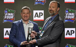 Texas Tech basketball coach Chris Beard, left, is presented The Associated Press College Basketball Coach of the Year Award by AP Sports Products Director Barry Bedlan, Thursday, April 4, 2019, in Minneapolis. (AP Photo/David J. Phillip)
