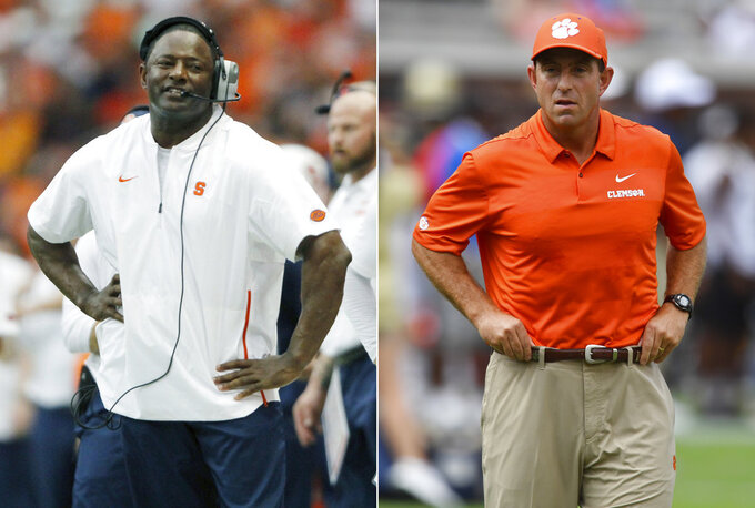 FILE - At left, in a Sept. 15, 2018, file photo, Syracuse head coach Dino Babers reacts late in the fourth quarter of an NCAA college football game against Florida State in Syracuse, N.Y. At right, in a Sept. 22, 2018, file photo, Clemson head coach Dabo Swinney watches teams warm up before the first half of an NCAA college football game against Georgia Tech, in Atlanta. Babers and Swinney share the coach of the year award as the Associated Press All-Atlantic Coast Conference teams and individual awards ewre released Tuesday, Dec. 4, 2018. (AP Photo/File)