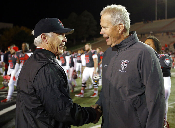 San Diego State coach Rocky Long, left, is congratulated by New Mexico coach Bob Davie after San Diego State beat New Mexico 31-23 in an NCAA college football game in Albuquerque, N.M., Saturday, Nov. 3, 2018. (AP Photo/Andres Leighton)