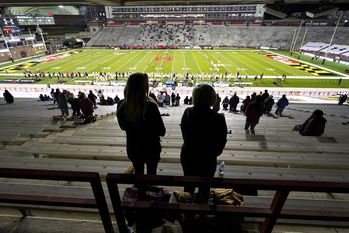 Minnesota fans are seen socially distanced while waiting for the opening kickoff against Maryland during an NCAA college football game, Friday, Oct. 30, 2020, in College Park, Md. (AP Photo/Julio Cortez)