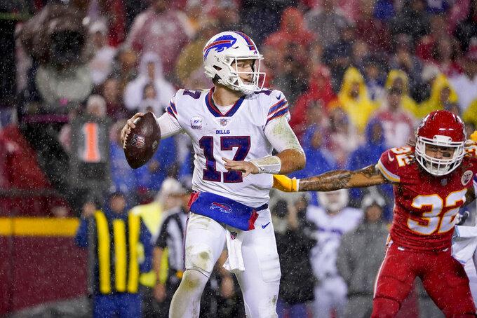 Buffalo Bills quarterback Josh Allen (17) throws under pressure from Kansas City Chiefs safety Tyrann Mathieu (32) during the second half of an NFL football game Sunday, Oct. 10, 2021, in Kansas City, Mo. (AP Photo/Ed Zurga)