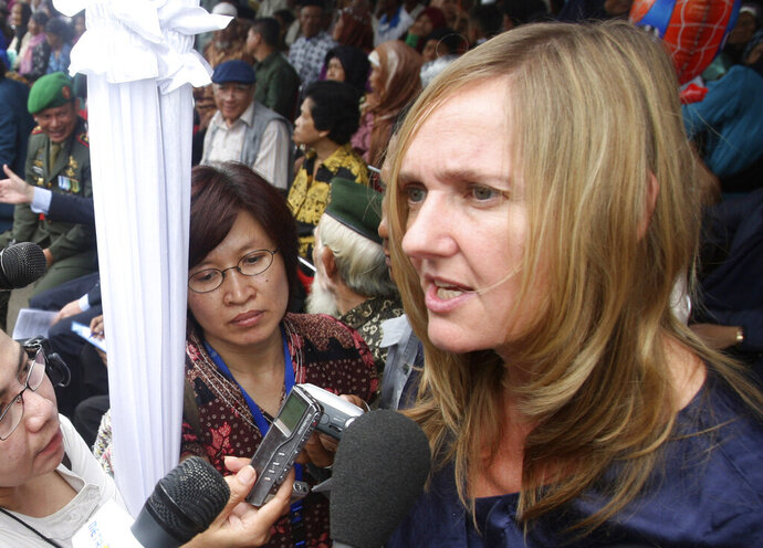 """FILE - in this file photo dated Friday, Dec. 9, 2011, Dutch Lawyer of surviving Indonesian widows Liesbeth Zegveld, right, talks to the media during commemoration in Rawagede, West Java, Indonesia. In a groundbreaking decision on Tuesday Oct. 1, 2019, an appeals court in the Netherlands ruled that the statute of limitations does not apply to allegations of colonial era crimes committed by Dutch forces in what is now Indonesia, lawyer Liesbeth Zegveld, who represented the claimants said """"I'm happy that the court has now issued this principal ruling."""".(AP Photo/Achmad Ibrahim, FILE)"""