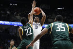 Xavier's Quentin Goodin (3) shoots over Siena's Jalen Pickett (22) during the first half of an NCAA college basketball game Friday, Nov. 8, 2019, in Cincinnati. (AP Photo/John Minchillo)