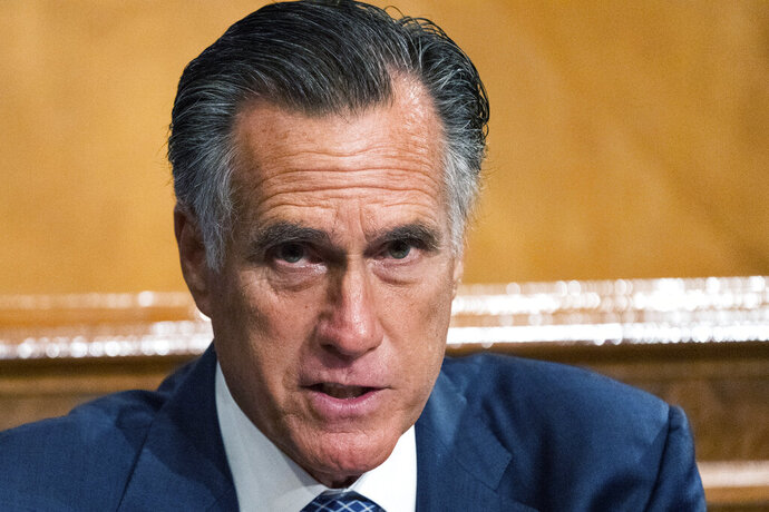 Senate Homeland Security and Governmental Affairs Committee member Sen. Mitt Romney, R-Utah, speaks during the committee's business meeting where it will consider new subpoenas in the