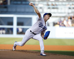 Los Angeles Dodgers starting pitcher Walker Buehler throws to a Chicago Cubs batter during the first inning of a baseball game in Los Angeles, Saturday, June 15, 2019. (AP Photo/Alex Gallardo)