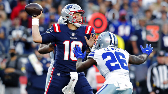New England Patriots quarterback Mac Jones (10) throws while pressured by Dallas Cowboys cornerback Jourdan Lewis (26) during the first half of an NFL football game, Sunday, Oct. 17, 2021, in Foxborough, Mass. (AP Photo/Michael Dwyer)