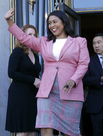 London Breed waves before speak to reporters outside of City Hall in San Francisco, Wednesday, June 13, 2018. Breed was poised to become the first African-American woman to lead San Francisco following a hard-fought campaign when former state senator Mark Leno conceded and congratulated her Wednesday, more than a week after the election. (AP Photo/Jeff Chiu)