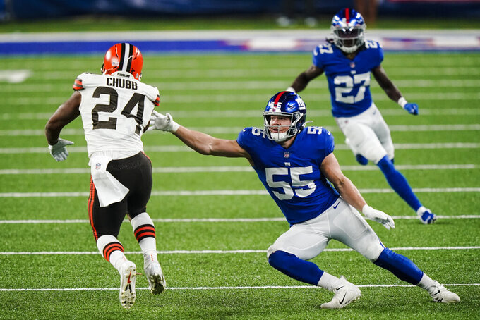Cleveland Browns' Nick Chubb (24) rushes past New York Giants outside linebacker David Mayo (55) during the second half of an NFL football game Sunday, Dec. 20, 2020, in East Rutherford, N.J. (AP Photo/Corey Sipkin)