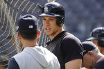 New York Yankees' Aaron Judge talks to a Yankees manager Aaron Boone during a baseball team workout Wednesday, Oct. 2, 2019, at Yankee Stadium in New York. Yankees will host the Minnesota Twins in the first game of an American League Division Series on Friday. (AP Photo/Frank Franklin II)