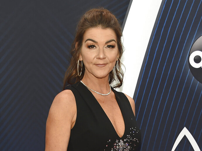 FILE - This Nov. 14, 2018 file photo shows Gretchen Wilson at the 52nd annual CMA Awards in Nashville, Tenn.  Wilson was removed from a New Mexico hotel after she performed at a weekend music festival. The Las Cruces Sun-News reported Wednesday, Oct. 16, 2019, that police were called to Hotel Encanto in Las Cruces around 3 a.m. Sunday after numerous noise complaints about Wilson's room. A police spokesman says she and her team left voluntarily. (Photo by Evan Agostini/Invision/AP, File)