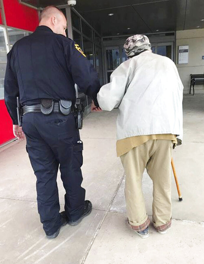 In this April 19, 2018, photo provided by the Montoursville Police Department in Montoursville, Pa., Jason Bentley, left, deputy chief of the department, escorts an 84-year-old man to see his wife, also 84, in the emergency department of UPMC Susquehanna hospital in Williamsport, Pa. After the elderly man's wife had a medical emergency and was taken from the couple's home by ambulance, Montoursville Police Chief Jeff Gyurina said he gave the man a patrol car's cellphone number because the man couldn't drive anymore and had no family in the area to take him to the hospital. (Montoursville Police Department via AP)