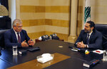 Lebanese Prime Minister Saad Hariri, right, meets with Russia's special presidential envoy to Syria Alexander Lavrentiev, in Beirut, Lebanon, Wednesday, June 19, 2019. Lavrentiev invited Lebanon to attend as an observer the next Moscow-backed meeting seeking a political solution in Syria to be held in Kazakh capital in July. (AP Photo/Bilal Hussein)