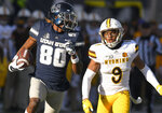 Utah State wide receiver Siaosi Mariner (80) runs down the field for an 80 yard touchdown reception as Wyoming cornerback Tyler Hall (9) defends during the first half of an NCAA football game Saturday, Nov. 16, 2019, in Logan, Utah. (Eli Lucero/The Herald Journal via AP)