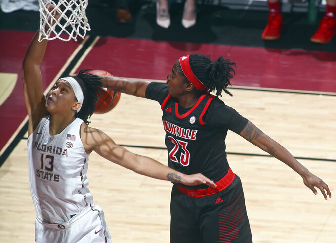 Florida State guard Nausia Woolfolk (13) has her layup rejected by Louisville guard Jazmine Jones (23) during the first half of an NCAA college basketball game in Tallahassee, Fla., Thursday, Jan. 24, 2019. (AP Photo/Phil Sears)
