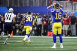 Los Angeles Rams' Jared Goff (16) reacts after throwing an interception caught by New England Patriots' Stephon Gilmore during the second half of the NFL Super Bowl 53 football game Sunday, Feb. 3, 2019, in Atlanta. (AP Photo/Patrick Semansky)