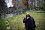 Milton I., 50, a resident living with schizophrenia at The Robert Meineker House, wipes his eyes as he speaks about the loneliness caused by social distancing in an empty common area, Wednesday, May 6, 2020, in the Brooklyn borough of New York. Even before the pandemic, access to mental health services in the U.S. could be difficult, including for people with insurance. Now experts fear COVID-19 will make the situation worse. (AP Photo/John Minchillo)