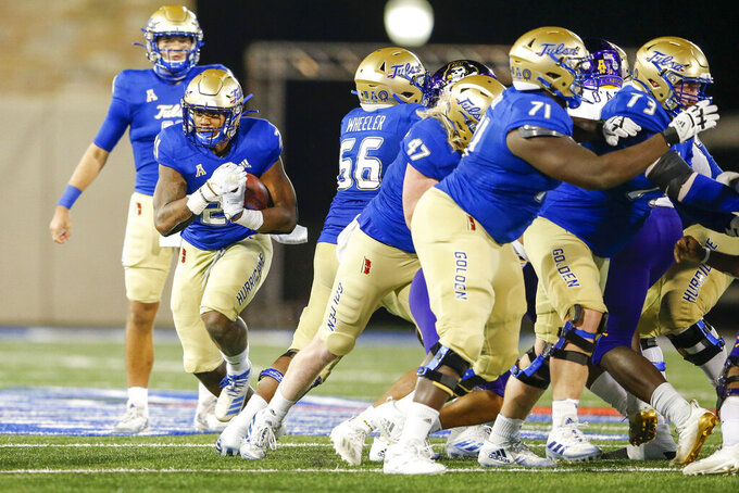 Tulsa Golden Hurricane running back TK Wilkerson (21) runs the ball during a NCAA football game in Tulsa. Okla. on Friday, Oct. 30, 2020.(Ian Maule/Tulsa World via AP)