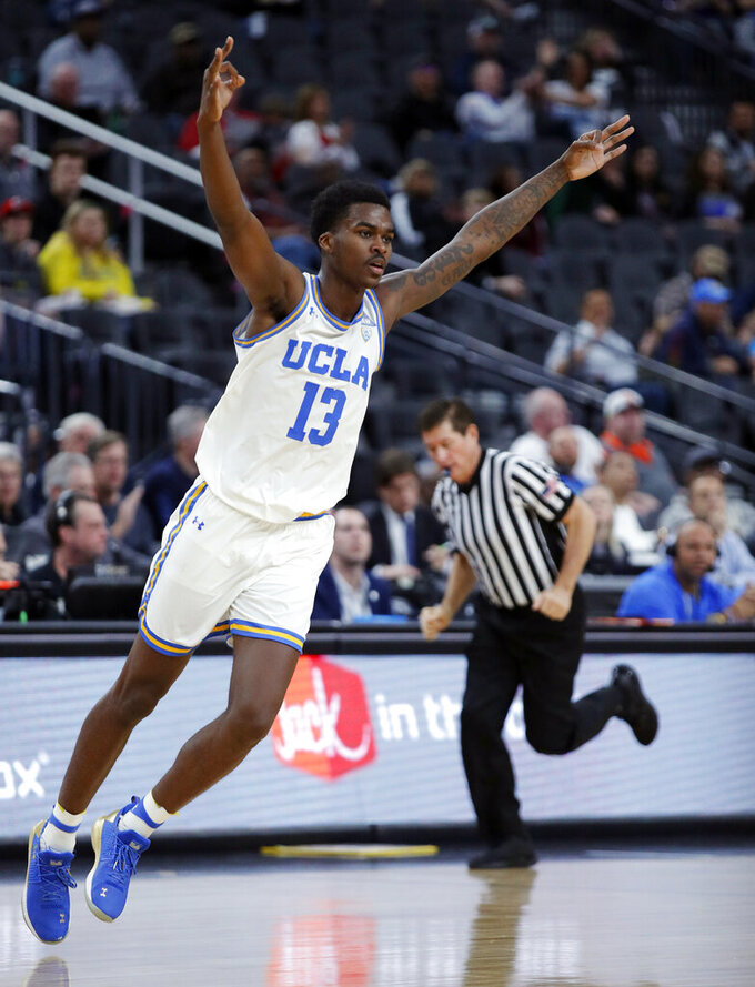 UCLA's Kris Wilkes celebrates after making a 3-point shot against Stanford during the second half of an NCAA college basketball game in the first round of the Pac-12 men's tournament, Wednesday, March 13, 2019, in Las Vegas. (AP Photo/John Locher)