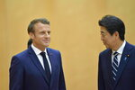 French President Emmanuel Macron, left, meets with Japanese Prime Minister Shinzo Abe prior to their meeting at Abe's official residence, Wednesday, June 26, 2019, in Tokyo. Macron will attend the G20 Osaka Summit which will be held on June 28th and 29th in Osaka. (David Mareuil/Pool Photo via AP)