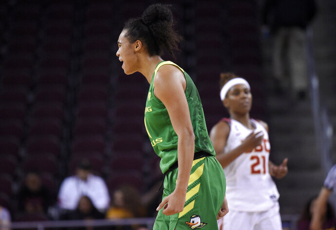 Oregon's Satou Sabally, front, celebrates after scoring as Southern California's Aliyah Mazyck walks in the background during the second half of an NCAA college basketball game Friday, Jan. 11, 2019, in Los Angeles. Oregon won 93-53. (AP Photo/Mark J. Terrill)