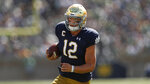Notre Dame quarterback Ian Book runs the ball against New Mexico in the first half of an NCAA college football game in South Bend, Ind., Saturday, Sept. 14, 2019. (AP Photo/Paul Sancya)