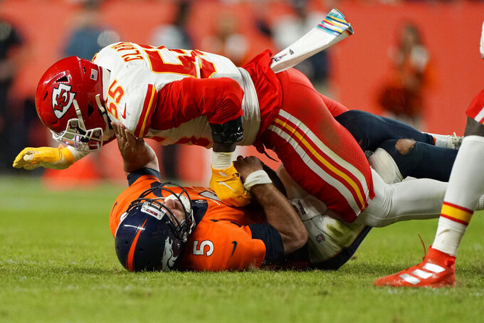 Denver Broncos quarterback Joe Flacco (5) is sacked by Kansas City Chiefs defensive end Frank Clark (55) during the first half of an NFL football game, Thursday, Oct. 17, 2019, in Denver. (AP Photo/Jack Dempsey)