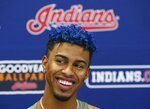 Cleveland Indians' Francisco Lindor smiles as he talks about his injury and his rehab workouts at a news conference at the teams spring training baseball facility Monday, Feb. 18, 2019, in Goodyear, Ariz. (AP Photo/Ross D. Franklin)