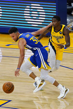 Golden State Warriors guard Stephen Curry (30) drives against Indiana Pacers guard Edmond Sumner (5) during the first half of an NBA basketball game in San Francisco, Tuesday, Jan. 12, 2021. (AP Photo/Jeff Chiu)