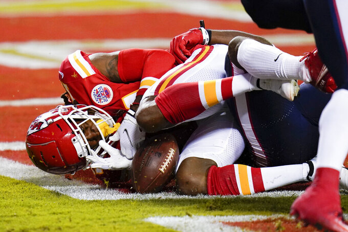 Kansas City Chiefs wide receiver Demarcus Robinson loses control of the ball in the end zone against the Houston Texans in the first half of an NFL football game Thursday, Sept. 10, 2020, in Kansas City, Mo. The play was ruled an incomplete pass. (AP Photo/Jeff Roberson)