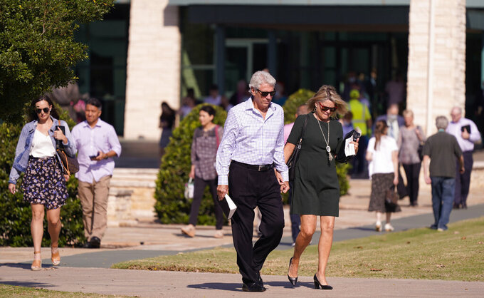 Members of Prestonwood Baptist Church walk from the church after morning services Sunday, Oct. 11, 2020, in Plano, Texas. Three weeks before the U.S. presidential election, an evangelical church in a Dallas suburb has emerged as a front for Republicans fighting to keep the diversifying state from flipping to Democratic presidential candidate Joe Biden.  (AP Photo/LM Otero)