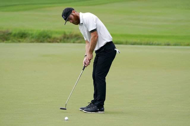 Tyler Mccumber putts on the seventh hole during the second round of the Wyndham Championship golf tournament at Sedgefield Country Club on Friday, Aug. 14, 2020, in Greensboro, N.C. (AP Photo/Chris Carlson)