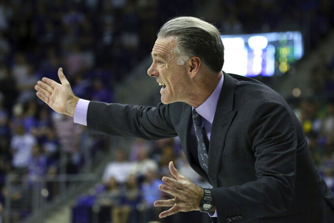 TCU head coach Jamie Dixon gestures from the sidelines during an NCAA college basketball game against Baylor on Saturday, Feb. 29, 2020 in Fort Worth, Texas. (AP Photo/Richard W. Rodriguez)