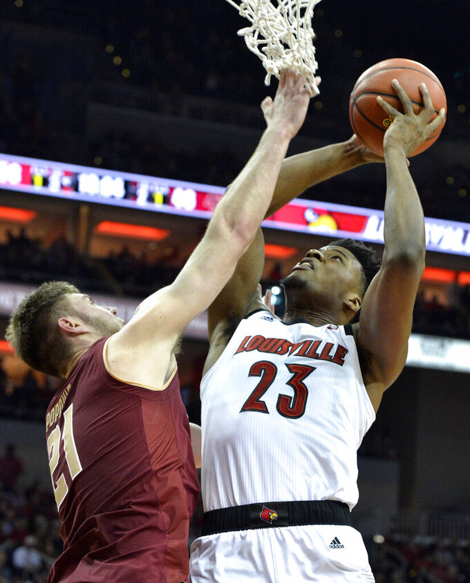 Louisville center Steven Enoch (23) attempts a shot over the defense of Boston College forward Nik Popovic (21) during the second half of an NCAA college basketball game in Louisville, Ky., Wednesday, Jan. 16, 2019. Louisville won 80-70. (AP Photo/Timothy D. Easley)