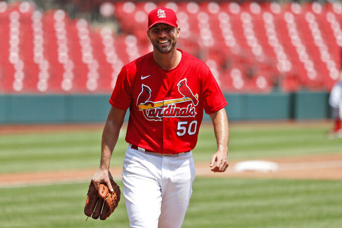 FILE - St. Louis Cardinals pitcher Adam Wainwright smiles after throwing a simulated inning during baseball practice at Busch Stadium in St. Louis, in this Sunday, July 5, 2020, file photo. Longtime St. Louis Cardinals pitcher Adam Wainwright has won the Roberto Clemente Award, given annually by Major League Baseball for community involvement and philanthropy. (AP Photo/Jeff Roberson, File)