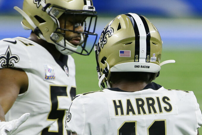 End Racism is seen on the back of New Orleans Saints wide receiver Deonte Harris' helmet during the first half of an NFL football game against the Detroit Lions, Sunday, Oct. 4, 2020, in Detroit. (AP Photo/Duane Burleson)
