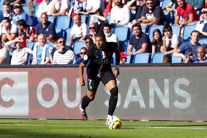 Paris Saint Germain's Kylian Mbappe controls the ball during a friendly soccer match between Paris Saint Germain and Le Havre, in Le Havre, western France, Sunday, July 12, 2020. (AP Photo/Thibault Camus)