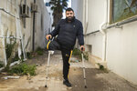 Muslim Gasdallah, 31, a protester who lost a leg after getting shot during Tunisia's democratic uprising 10 years ago poses for a portrait in Tunis, Tunisia, Tuesday, Jan. 12, 2021. (AP Photo/Mosa'ab Elshamy)