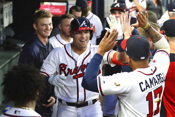 Atlanta Braves outfielder Austin Riley gets high fives in the dugout after hitting a solo home run against the St. Louis Cardinals during the fourth inning of a baseball game, Wednesday, May 15, 2019, in Atlanta. (Curtis Compton/Atlanta Journal-Constitution via AP)