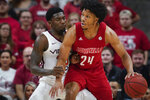 Louisville forward Dwayne Sutton (24) plays against Virginia Tech guard Tyrece Radford (23) during the first half of an NCAA college basketball game, Sunday, March 1, 2020, in Louisville, Ky. (AP Photo/Bryan Woolston)