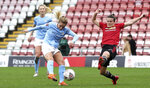 Manchester City's Laura Coombs, left, scores her side's second goal of the game, during the Women's Super League soccer match against Machester United at Leigh Sports Village, in Manchester, England, Saturday Nov. 14, 2020. (Martin Rickett/PA via AP)