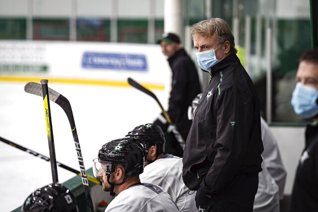 FILE -In this Tuesday, July 14, 2020, file photo, provided by the Dallas Stars NHL hockey team, interim head coach Rick Bowness watches practice in Frisco, Texas, The Stars have been mired in a six-game winless streak for more than four months, and now have a chance to be a No. 1 seed with the NHL going directly into the playoffs to resume its season. (Jeff Toates/Dallas Stars via AP, FIle)