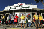 FILE - In this Jan. 2, 2012, file photo, Wisconsin and Oregon fans arrive for the Rose Bowl NCAA college football game in Pasadena, Calif. No spectators will be allowed at the Rose Bowl for the College Football Playoff semifinal on Jan. 1 because of COVID-19 restrictions imposed by the state, county and city of Pasadena, The Tournament of Roses said Thursday, Dec. 3, 2020. (AP Photo/Matt Sayles, File)