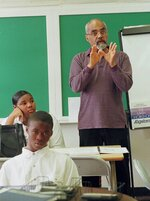 """FILE  - In this April 6, 1990 file photo, Robert """"Bob"""" Moses teaches an algebra class at Lanier High School in Jackson, Miss.  Moses, a civil rights activist who endured beatings and jail while leading Black voter registration drives in the American South during the 1960s and later helped improve minority education in math, died Sunday, July 25, 2021, in Hollywood, Fla. He was 86.  (AP Photo/Rogelio Solis, File)"""
