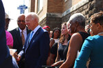 Former Vice President and presidential candidate Joe Biden, center, left, speaks with an attendee as he joins Sen. Doug Jones and Birmingham Mayor Randall Woodfin at a wreath laying after a service at 16th Street Baptist Church in Birmingham, Ala., Sunday, Sept. 15, 2019. Visiting the black church bombed by the Ku Klux Klan in the civil rights era, Democratic presidential candidate Biden said Sunday the country hasn't