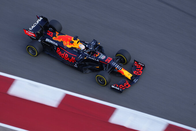 Red Bull driver Max Verstappen, of the Netherlands, moves into a turn during a practice session for the F1 US Grand Prix auto race at Circuit of the Americas, Friday, Oct. 22, 2021, in Austin, Texas. (AP Photo/Nick Didlick)