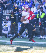 Western Kentucky wide receiver Jacquez Sloan (2) scores a touchdown against Southern Mississippi during an NCAA college football game, Saturday, Nov. 23, 2019. (Cam Bonelli/Hattiesburg American via AP)